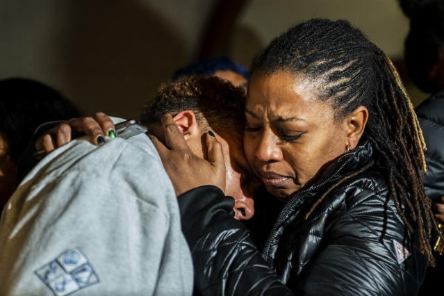 Christian Carter, of Pittsburgh's East Liberty neighborhood, left, is consoled by an unidentified woman after they learned a not guilty verdict in the homicide trial of former East Pittsburgh police Officer Michael Rosfeld, Friday, March 22, 2019, at the Allegheny County Courthouse in downtown Pittsburgh, Pa. A jury acquitted Rosfeld, a former police officer Friday in the fatal shooting of Antwon Rose II, an unarmed teenager as he was fleeing a high-stakes traffic stop outside Pittsburgh, a confrontation that was captured on video and led to weeks of unrest. (Michael M. Santiago/Pittsburgh Post-Gazette via AP)