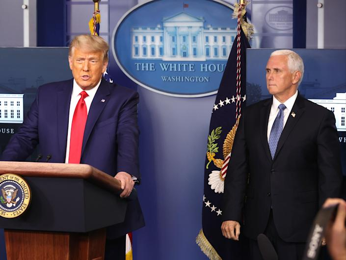 Then-President Donald Trump speaks as then-Vice President Mike Pence looks on in the James Brady Press Briefing Room at the White House on November 24, 2020.  (Getty Images)