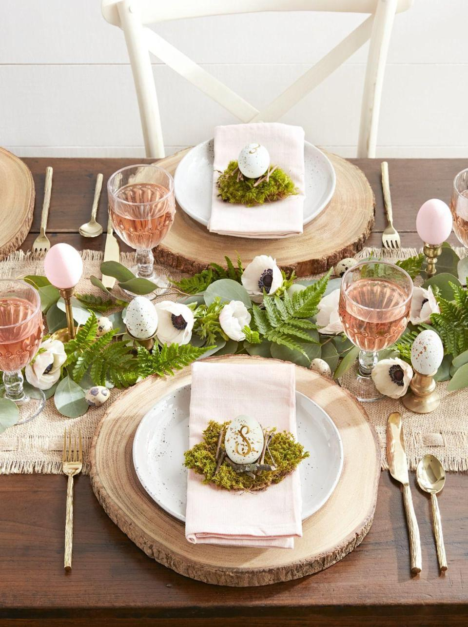 """<p>To give this homey, woodland spread a classic allure, use a gold paint pen to decorate eggs with each guests' monogram.</p><p><a rel=""""nofollow noopener"""" href=""""https://www.amazon.com/Sharpie-Oil-Based-Marker-Medium-Metallic/dp/B00E3XXN68/"""" target=""""_blank"""" data-ylk=""""slk:SHOP GOLD PAINT PENS"""" class=""""link rapid-noclick-resp"""">SHOP GOLD PAINT PENS</a> </p>"""