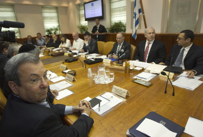 Israel's Minister Ehud Barak, left, sits across from the Prime Minister Benjamin Netanyahu during the weekly cabinet meeting in Jerusalem Sunday, April 29, 2012. (AP Photo/Ronen Zvulun, Pool)