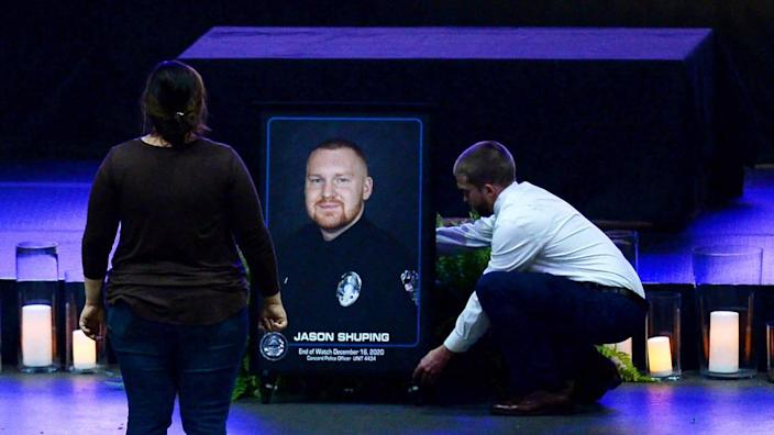 A portrait of fallen Concord police Officer Jason Shuping is positioned at the Cabarrus Arena and Events Center on Tuesday, December 22, 2020. Shuping was killed in the line of duty last week while responding to an attempted carjacking outside a fast food restaurant in Concord, NC.