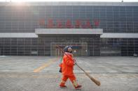 A cleaner walks past the Sihui Long Distance Bus Station in Beijing after the city has stoped inter-province buses services as the country is hit by an outbreak of the new coronavirus