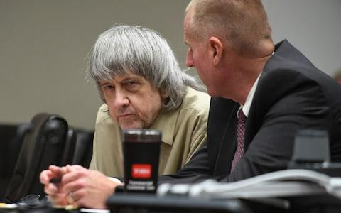 <span>David Turpin, left, listens to his attorney during a sentencing hearing Friday</span> <span>Credit: AP </span>