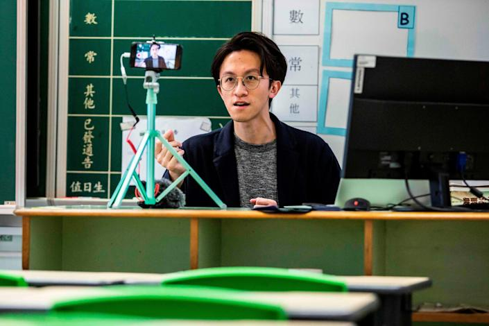 A teacher records a video lesson for his students in Hong Kong in early March 2020.