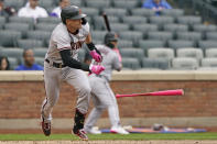 Arizona Diamondbacks' Nick Ahmed drops the bat after hitting into an RBI-groundout during the fifth inning of a baseball game against the New York Mets, Sunday, May 9, 2021, in New York. (AP Photo/Kathy Willens)