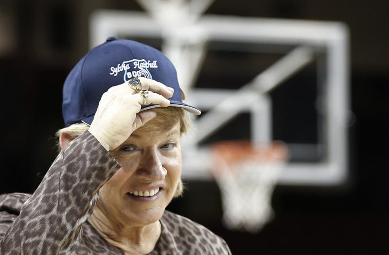 North Carolina coach Sylvia Hatchell wears a hat in honor of her 900th career win, following North Carolina's 80-52 win over Boston College in an NCAA college basketball game in Boston on Thursday, Feb. 7, 2013. (AP Photo/Winslow Townson)