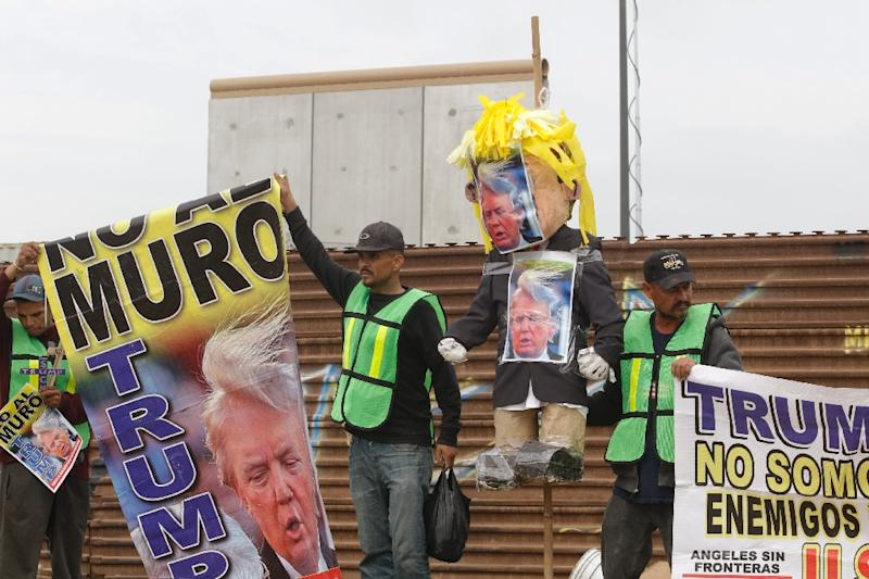 Demonstrators in Tijuana paraded with a pinata version of Trump -- which police persuaded them not to burn (AFP Photo/Guillermo Arias)