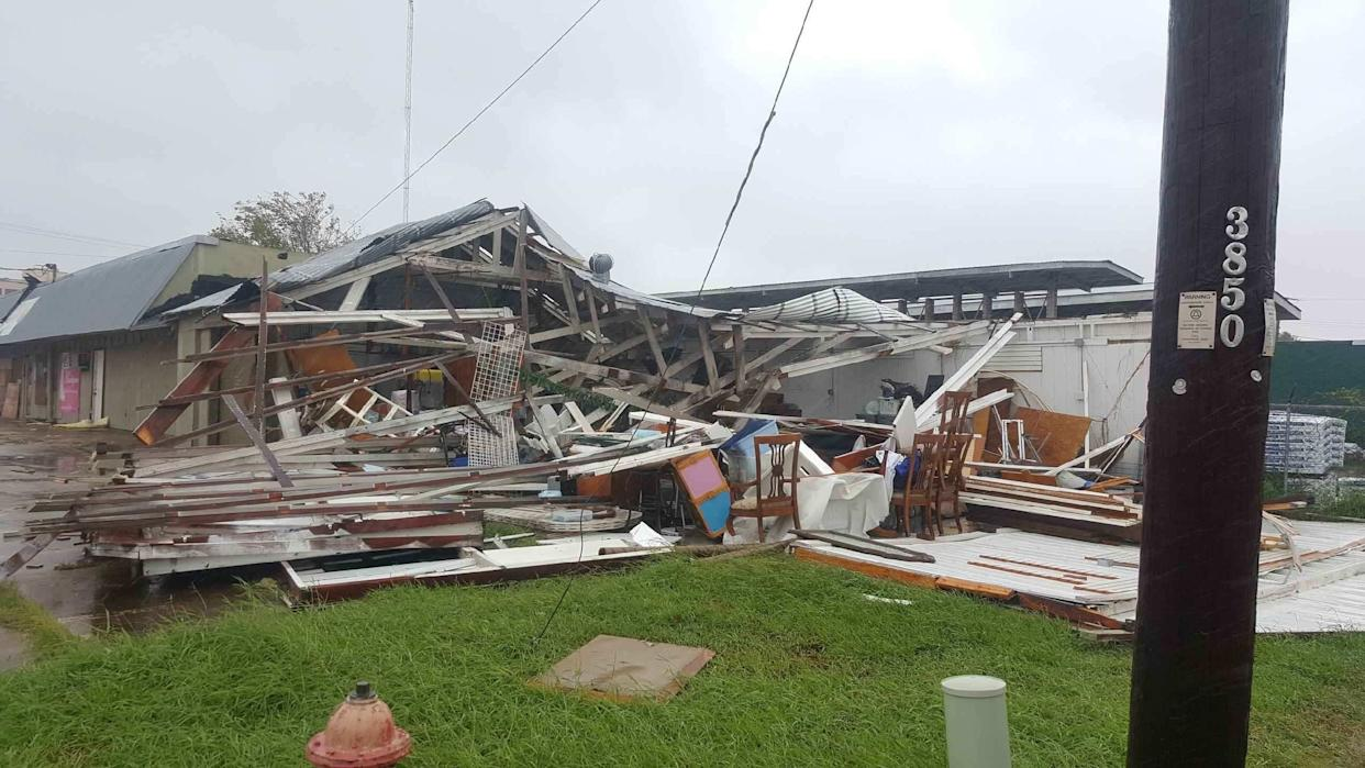 Damage is seen to a shopping center in Victoria, north and farther inland than Rockport.