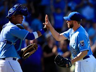 Greg Holland (right) has 37 saves for the Royals. (Getty)