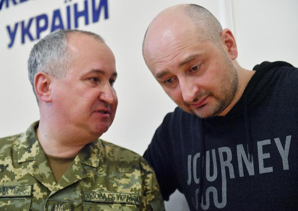 Russian anti-Kremlin journalist Arkady Babchenko, who was reported killed, stunned everyone by appearing at a Kiev press conference with the head of Ukraine's security service, Vasyl Grytsak (AFP Photo/Sergei SUPINSKY)