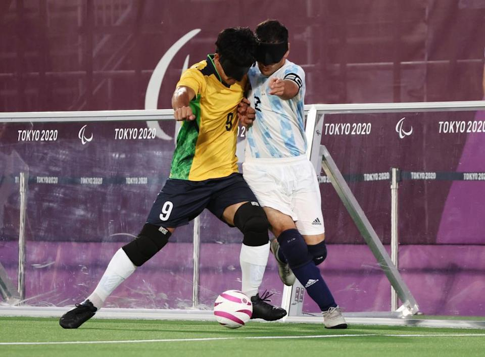 Tiago da Silva of Brazil in action with Angel Deldo Garcia of Argentina in the football five-a-side final.