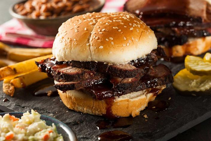 """<p><strong>Barbecue Brisket</strong></p><p>Of course Texas would be known for the Barbecue Brisket. Served on a roll or toast, chopped or sliced barbecue beef is hard to miss in Texas. They're slow-smoked for hours (12-18 to be exact) with fixings that include pickles, onions and jalapeño peppers. Try it at <a href=""""https://tylersbarbeque.com/"""" rel=""""nofollow noopener"""" target=""""_blank"""" data-ylk=""""slk:Tyler's Barbeque"""" class=""""link rapid-noclick-resp"""">Tyler's Barbeque</a>. </p>"""