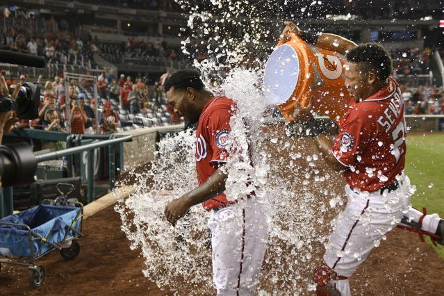 Howie Kendrick, here being doused after a walk-off grand slam on Aug. 13, has filled a multitude of roles for the banged-up Nationals. (AP Photo/Nick Wass)