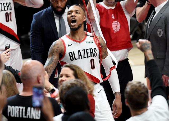 Damian Lillard soaks in the moment after his game-winning and series-clinching shot Tuesday night in Portland. (Getty Images)
