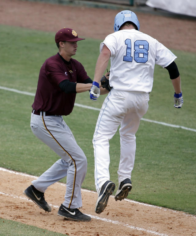 Bethune-Cookman pitcher John Sever, left, tages out Columbia's David Vandercook, right, in the eighth inning during an NCAA college baseball regional tournament in Coral Gables, Fla., Saturday, May 31, 2014. Bethune-Cookman defeated Columbia 6-5. (AP Photo/Lynne Sladky)
