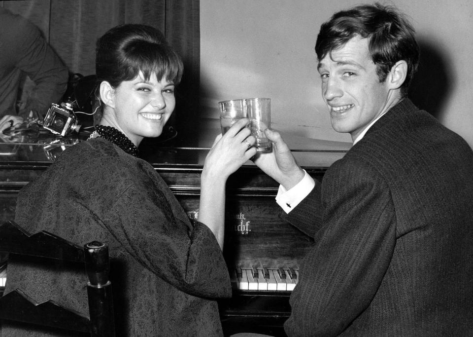 FILE - In this Nov. 3, 1960 file photo, French actor Jean-Paul Belmondo and Italian actress Claudia Cardinale attend a cocktail party in the Foreign Press Association in Rome. French New Wave actor Jean-Paul Belmondo has died, according to his lawyer's office on Monday Sept. 6, 2021. (AP Photo/Mario Torrisi, File)