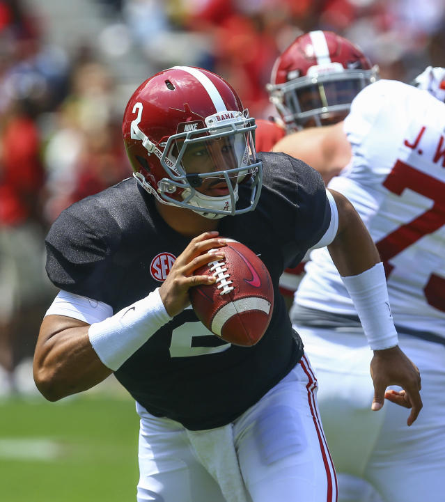 White quarterback Jalen Hurts scrambles during the first half of an NCAA college football Alabama spring game, Saturday, April 21, 2018, in Tuscaloosa, Ala. (AP Photo/Butch Dill)