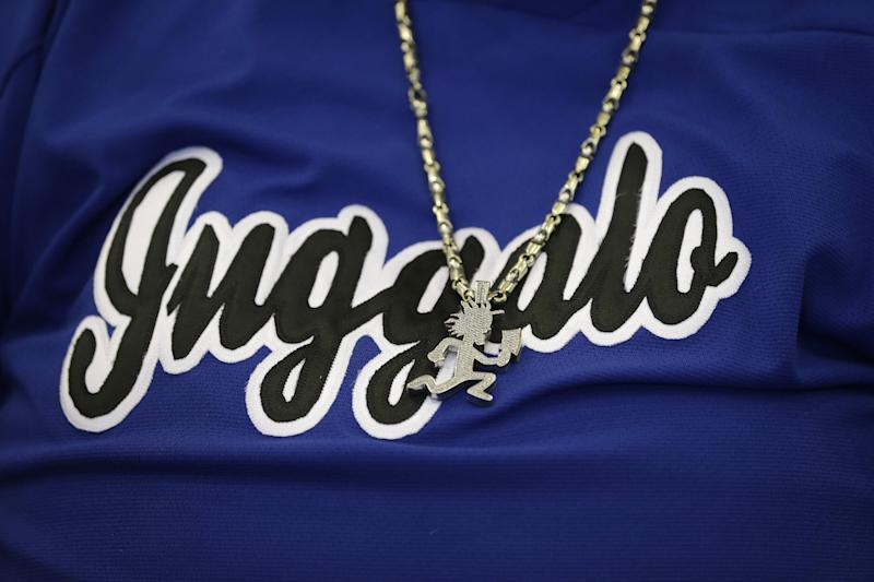 A closeup of Juggalo name and symbol worn by Joseph Bruce aka Violent J, a member of the Insane Clown Posse as he addresses the media in Detroit, Wednesday, Jan. 8, 2014. The rap metal group sued the U.S. Justice Department on Wednesday over a 2011 FBI report that describes the duo's devoted fans, the Juggalos, as a dangerous gang, saying the designation has tarnished their fans' reputations and hurt business. The American Civil Liberties Union filed the lawsuit in Detroit federal court on behalf of the group's two members. (AP Photo/Carlos Osorio)