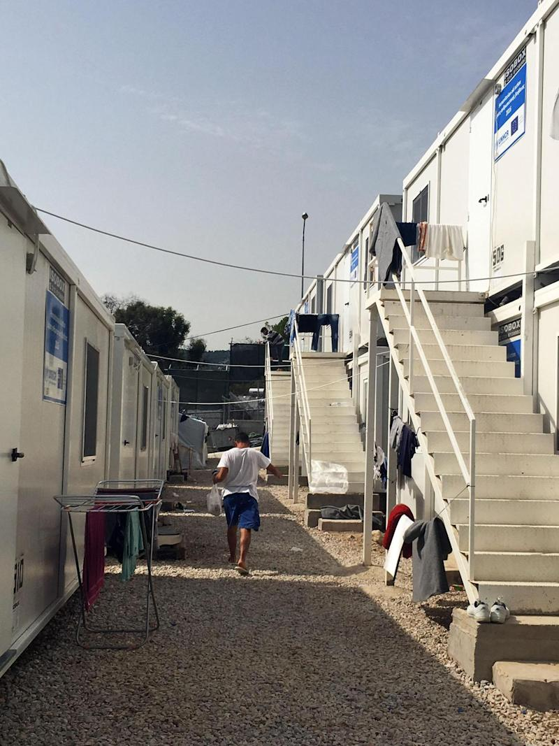 Some refugees live in shipping containers at the refugee camp, while others live in tents (Janice Dickson)