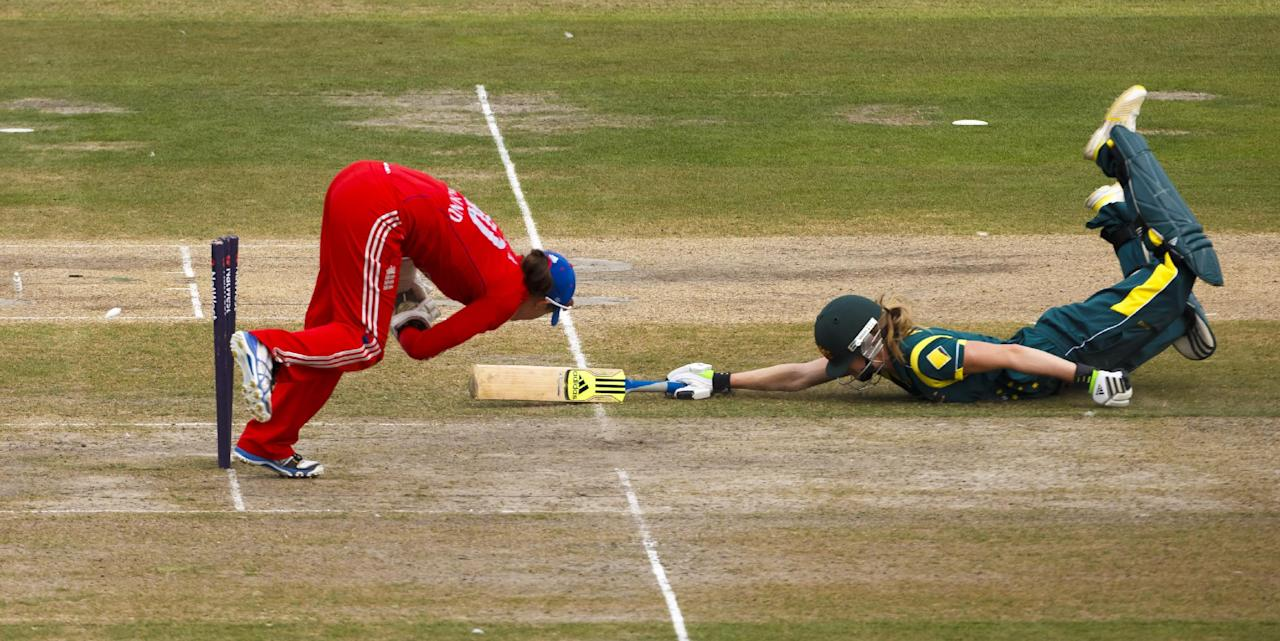 Australia's Ellyse Perry is run out by England's Sarah Taylor during the One Day International at The County Ground, Hove.