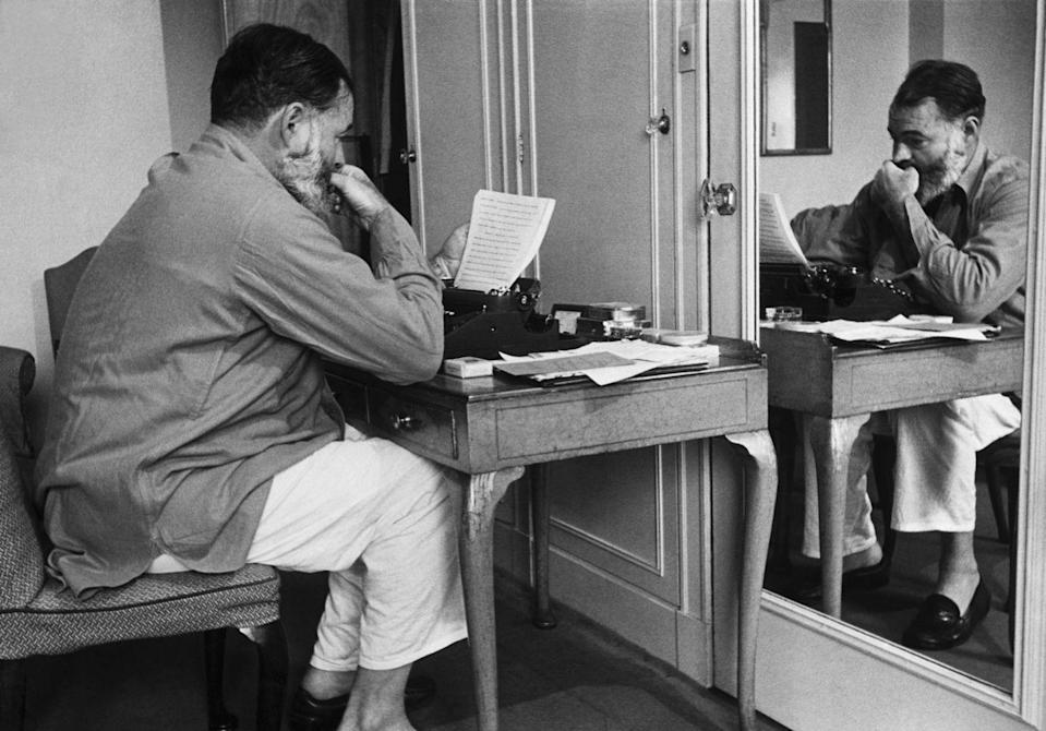 <p>While working as a war correspondent, Hemingway sits at his famous typewriter to pen a dispatch for back home. </p>