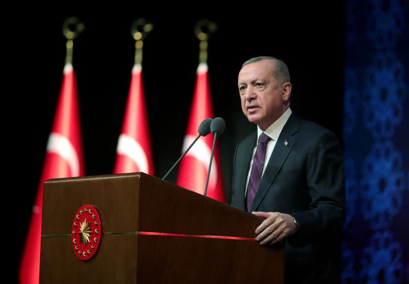 FILE PHOTO: Turkish President Erdogan speaks during a meeting to unveil the Human Rights Action Plan in Ankara