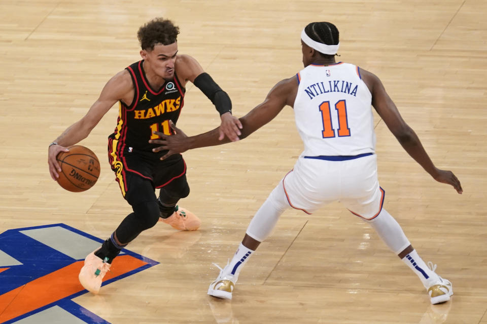 NEW YORK, NY - MAY 23: New York Knicks' Frank Ntilikina, right, guards Atlanta Hawks' Trae Young during the second half of Game 1 of an NBA basketball first-round playoff series on May 23, 2021 in New York City. The Hawks defeated the Knicks 107-105. NOTE TO USER: User expressly acknowledges and agrees that,  by downloading and or using this photograph,  User is consenting to the terms and conditions of the Getty Images License Agreement. (Photo by Seth Wenig - Pool/Getty Images)