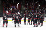 The Carolina Hurricanes salute the fans, who returned to PNC Arena for the first time this season, after a win over the Detroit Red Wings in an NHL hockey game in Raleigh, N.C., Thursday, March 4, 2021. AP Photo/Chris Seward)