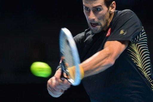 Serbia's Novak Djokovic returns against Switzerland's Roger Federer during the singles final on the eighth day of the ATP World Tour Finals tennis tournament in London. Djokovic produced a masterful display to end Federer's reign as ATP Tour Finals champion as the world number one swept to a 7-6 (8/6), 7-5 victory in the final