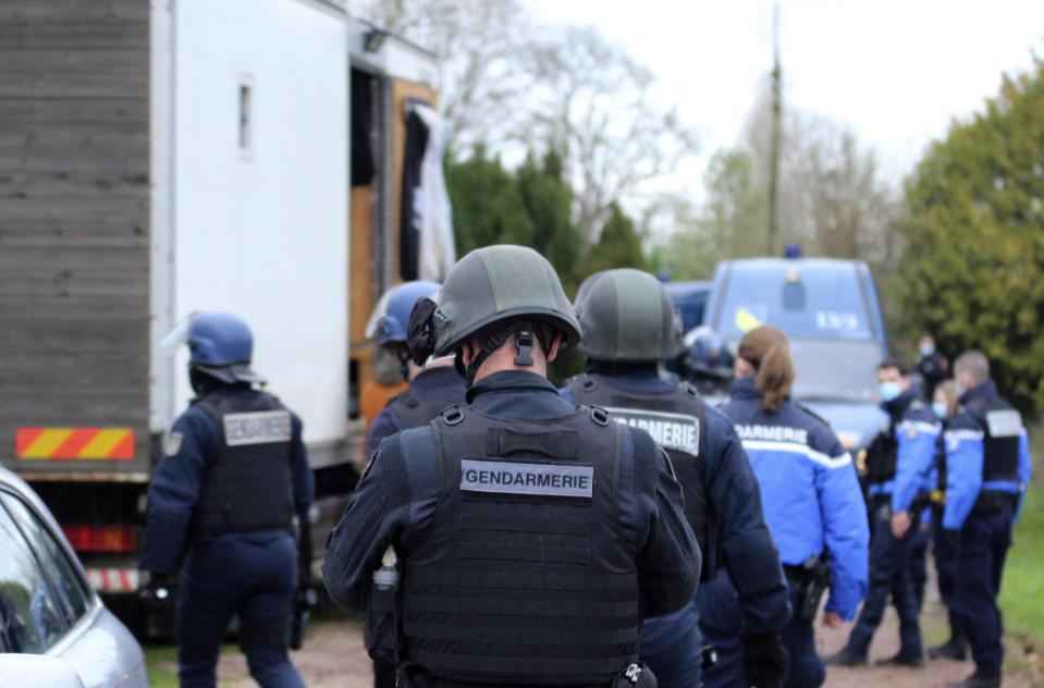 In this photo providedby the French Gendarmerie, gendarmes are deployed, near Lieuron, Brittany, France, Saturday, Jan. 2, 2021. A French prosecutor said police detained seven people Saturday, including two alleged organizers, after a New Year's Eve rave party drew at least 2,500 people in western France despite a coronavirus curfew and other restrictions. (Gendarmerie Nationale via AP)