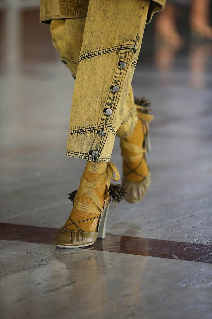Ulla Johnson's fall '21 collection featured hyrid-heels with bold straps paired with colorful tights, all various yellow hues. - Credit: Courtesy of Ulla Johnson