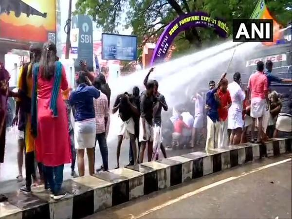 Thiruvananthapuram: Police use water cannon against BJP Yuva Morcha members protesting outside Kerala Assembly. (Photo/ANI)