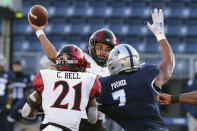 San Diego State quarterback Kaegun Williams, center, throws a first-down pass against Nevada during the second half of an NCAA college football game Saturday, Nov. 21, 2020, in Reno, Nev (AP Photo/Lance Iversen)