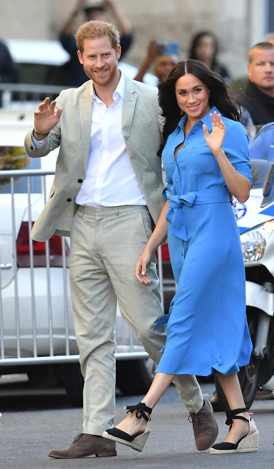The Duke and Duchess of Sussex arrive for a visit to the District Six Museum in Cape Town. [Photo: Getty]