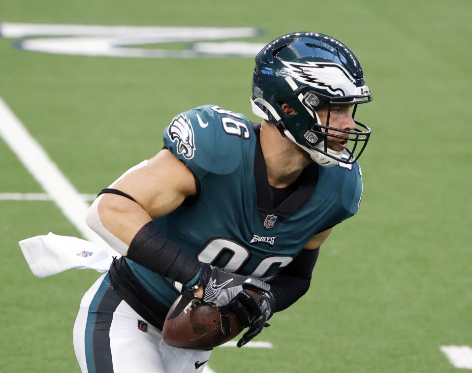 FILE - In this Dec. 27, 2020, file photo, Philadelphia Eagles tight end Zach Ertz catches a pass prior to an NFL football game in Arlington, Texas. Even during a pandemic with ticket sales limited and the off-the-field events drastically scaled back, an event like the Super Bowl also brings with it a heightened risk of human trafficking. Ertz is among a handful of NFL players whove joined the cause to help fight such atrocities. (AP Photo/Michael Ainsworth, File)