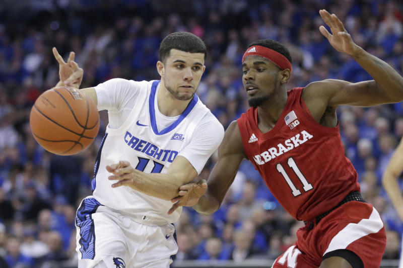 Creighton's Marcus Zegarowski (11) passes the ball away from Nebraska's Dachon Burke Jr., right, during the first half of an NCAA college basketball game in Omaha, Neb., Saturday, Dec. 7, 2019. (AP Photo/Nati Harnik)