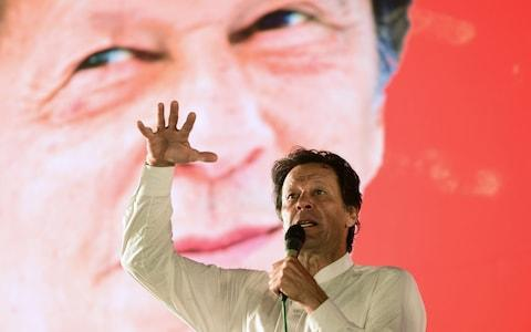 Pakistani cricket star-turned-politician and head of the Pakistan Tehreek-e-Insaf (PTI) Imran Khan addresses a political campaign rally ahead of the general election in Islamabad on July 21, 2018 - Credit: Farooq Naeem/AFP