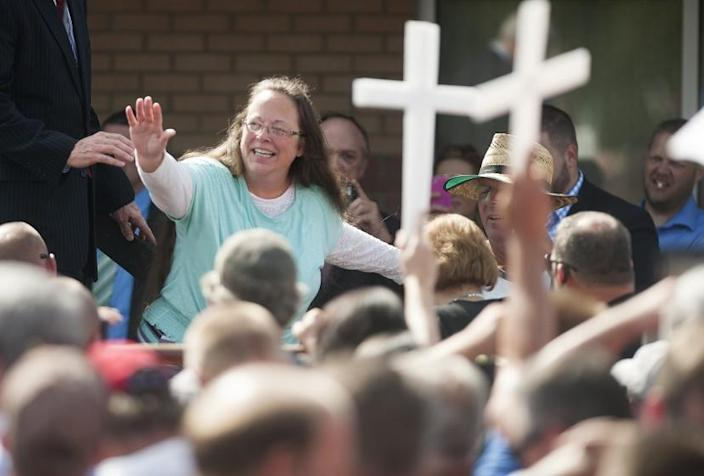 Rowan County Clerk Kim Davis waves to supporters in front of the Carter County Detention Center on in Grayson, Kentucky, on Sept. 8.