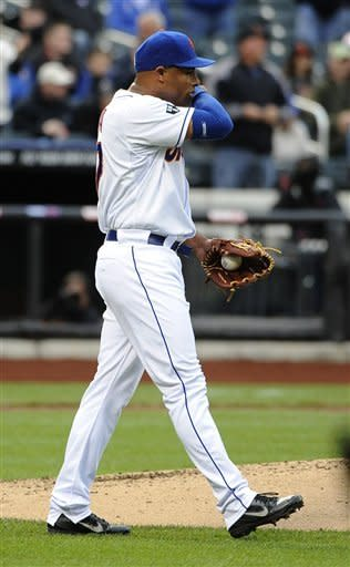 New York Mets pitcher Miguel Batista walks near the mound after San Francisco Giants' Nate Schierholtz hit a three-run home run in the third inning of the first game of a baseball doubleheader, Monday, April 23, 2012, in New York. (AP Photo/Kathy Kmonicek)