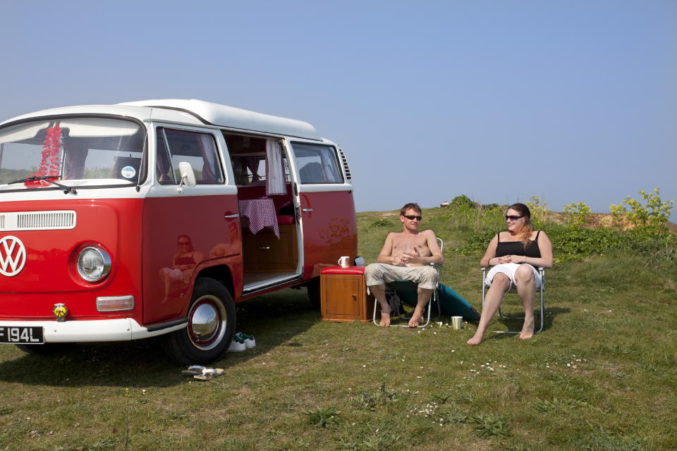 A young couple camping in a VW campervan on the clifftops over Mundesley on the Norfolk coast. (Photo: Loop Images/Universal Images Group via Getty Images)
