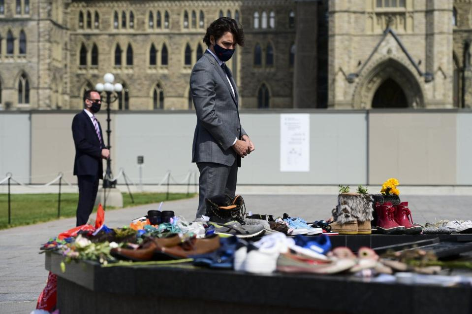 """<span class=""""caption"""">Prime Minister Justin Trudeau visits a memorial on Parliament Hill in recognition of the discovery of children's remains at the site of a former residential school in Kamloops, B.C. </span> <span class=""""attribution""""><span class=""""source"""">THE CANADIAN PRESS/Sean Kilpatrick </span></span>"""