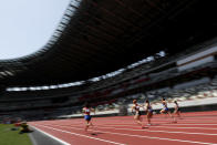 Japanese woman athletes compete during their 100 meter race at an athletics test event for the Tokyo 2020 Olympics Games at National Stadium in Tokyo, Sunday, May 9, 2021. (AP Photo/Shuji Kajiyama)