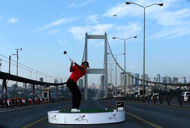 ISTANBUL, TURKEY - NOVEMBER 05: Tiger Woods of the USA the World Number One makes history as he hits the first golf shots from East to West on Istanbul's iconic Bosphorous Bridge linking Asia and Europe on November 5, 2013 in Istanbul, Turkey. (Photo by Warren Little/Getty Images)