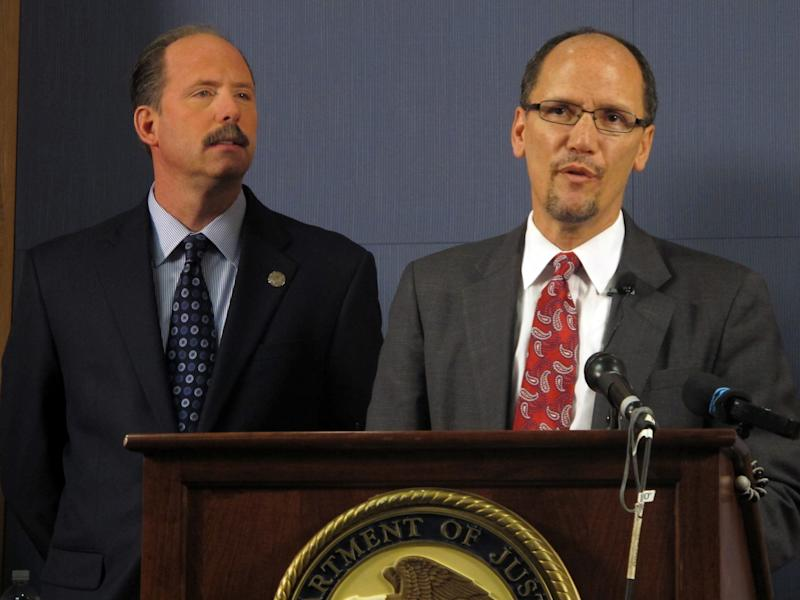 Thomas E. Perez, Assistant Attorney General for the Civil Rights Division is shown with Albuquerque Mayor Richard Berry, left, at a press conference Tuesday Nov. 27, 2012, in Albuquerque, N.M. announcing a federal investigation into the Albuquerque Police Department. The U.S. Justice Department says it will conduct a thorough investigation of the Albuquerque Police Department after a string of officer-involved shootings and a number of high-profile abuse cases alleging the use of excessive and deadly force. (AP Photo/Russell Contreras)