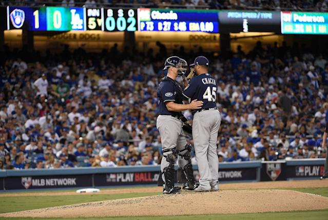 Jhoulys Chacín and Erik Kratz found themselves standing on a tiny hill in a massive stadium on Monday night. (Getty Images)
