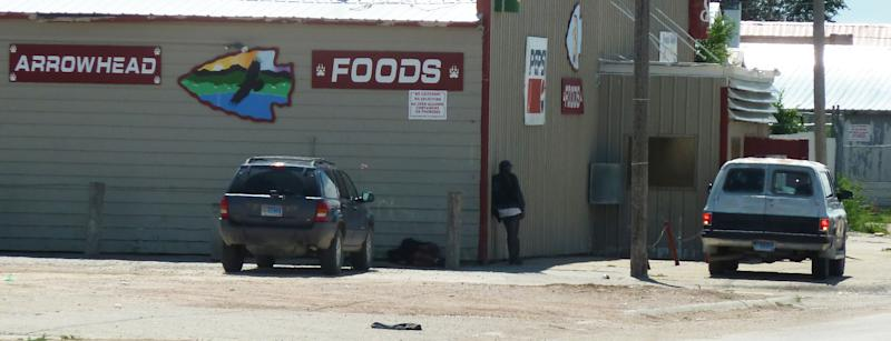 In this Aug. 8, 2013, photo is one of the businesses in Whiteclay, Neb., just south of the Pine Ridge Indian Reservation where residents are deciding whether to legalize alcohol. Despite that acknowledgement by Oglala Sioux Tribe leaders, a majority of the council passed a public referendum in June that led to a special election Tuesday, Aug. 13 on whether to end prohibition and allow the tribe to sell alcohol and use the profits for education and detoxification and treatment centers, for which there is currently little to no funding. (AP Photo/Carson Walker)