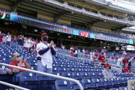 Fans sit socially-distanced in the stands before an opening day baseball game between the Atlanta Braves and the Washington Nationals at Nationals Park, Tuesday, April 6, 2021, in Washington. (AP Photo/Alex Brandon)