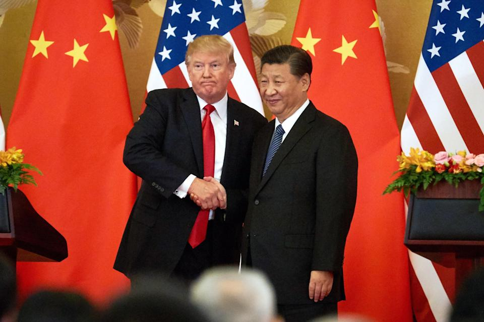 BEIJING, CHINA – NOVEMBER 9, 2017: US President Donald Trump (L) and China's President Xi Jinping shake hands at a press conference following their meeting at the Great Hall of the People in Beijing. Artyom Ivanov/TASS (Photo by Artyom Ivanov\TASS via Getty Images)