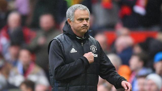 Jose Mourinho points to the Manchester United badge as he walks off Old Trafford after defeating Chelsea 2-0