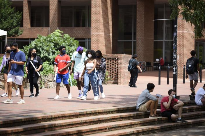 "<span class=""caption"">The University of North Carolina at Chapel Hill shifted to online learning in August after a COVID-19 outbreak.</span> <span class=""attribution""><a class=""link rapid-noclick-resp"" href=""https://www.gettyimages.com/detail/news-photo/students-walk-through-the-campus-of-the-university-of-north-news-photo/1228095554"" rel=""nofollow noopener"" target=""_blank"" data-ylk=""slk:Melissa Sue Gerrits/Getty Images"">Melissa Sue Gerrits/Getty Images</a></span>"